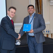 Nick Fordham, Managing Director at Alain Charles Publishing presents a gift voucher to our lucky draw winner on the occasion of the 5th anniversary of DHSE forum